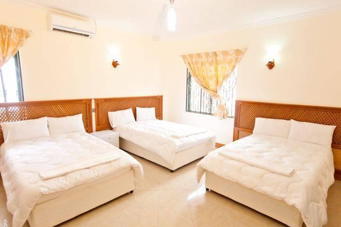Arusha Travel Lodge, Arusha Chini, Tanzania, Tanzania giường ngủ và bữa ăn sáng và khách sạn