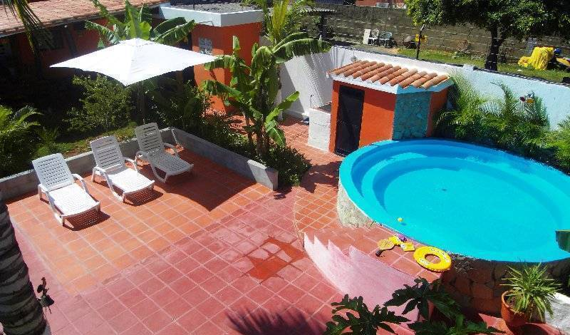 Posada Casa Rosa - Get cheap hostel rates and check availability in Playa El Agua 9 photos