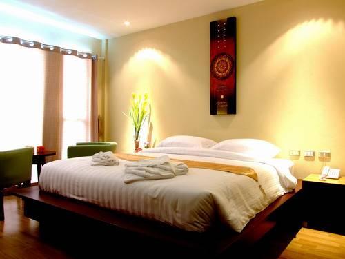 Bhukitta Hotel and Spa, Karon Beach, Thailand, Thailand giường ngủ và bữa ăn sáng và khách sạn